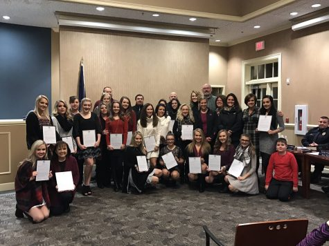 Cheerleaders and coach recognized for accomplishments