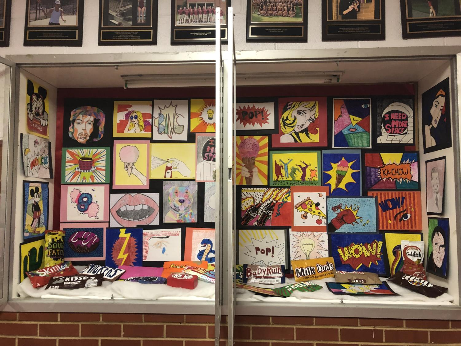 Art student's pop art pieces got added to the display case.
