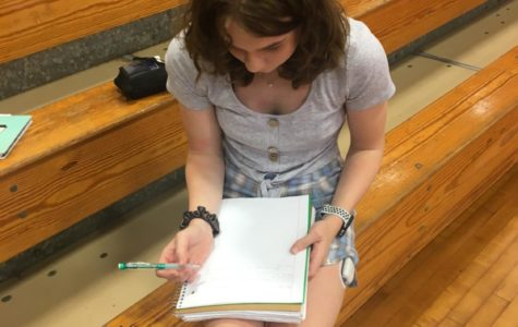 Student works on assignments before PE class begins