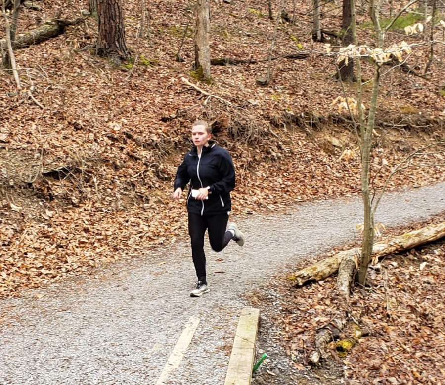 Lauren Pearce (10) finishes a lap on the trails at the city park.
